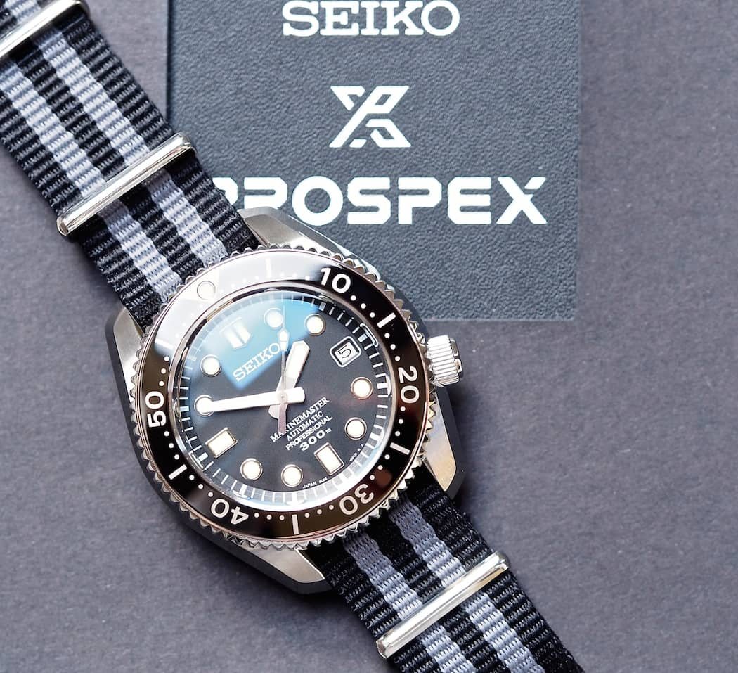 The Seiko MM300 on top of its simple box
