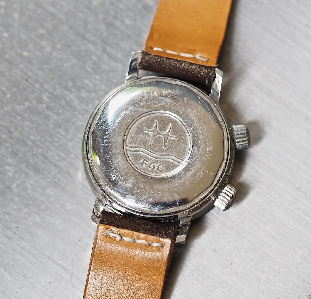 The case back of the Hamilton 600 indicates water resistance of the same number in feet