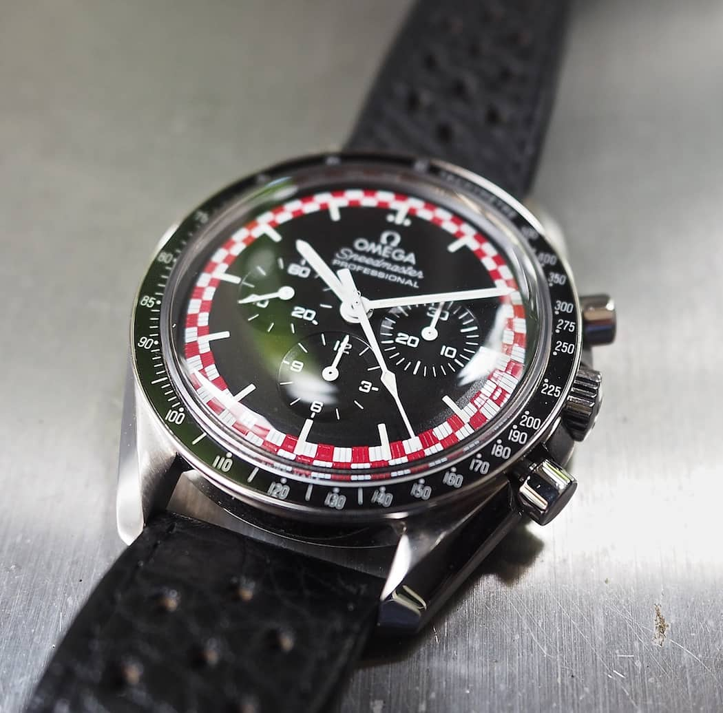 Note the gloss on the red used in the outer track of the Speedmaster TinTin