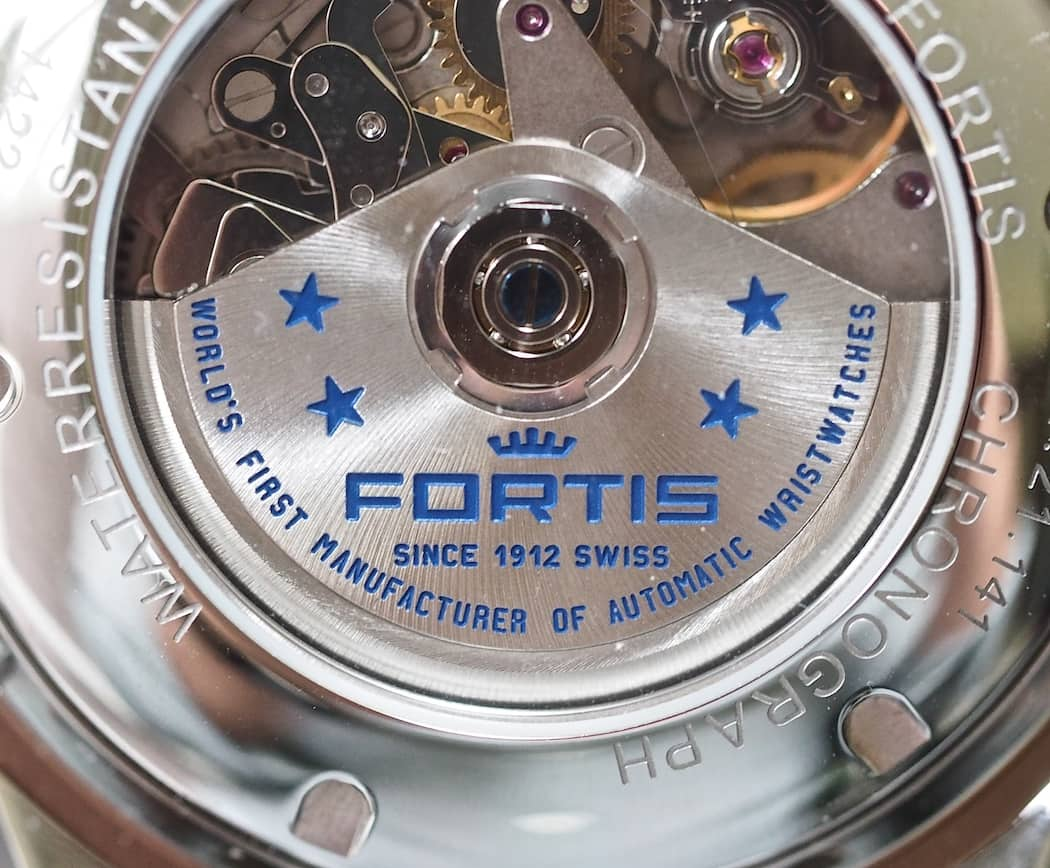 The blue engraved rotor on the Valjoux 7750 found within the Fortis Classic Cosmonauts