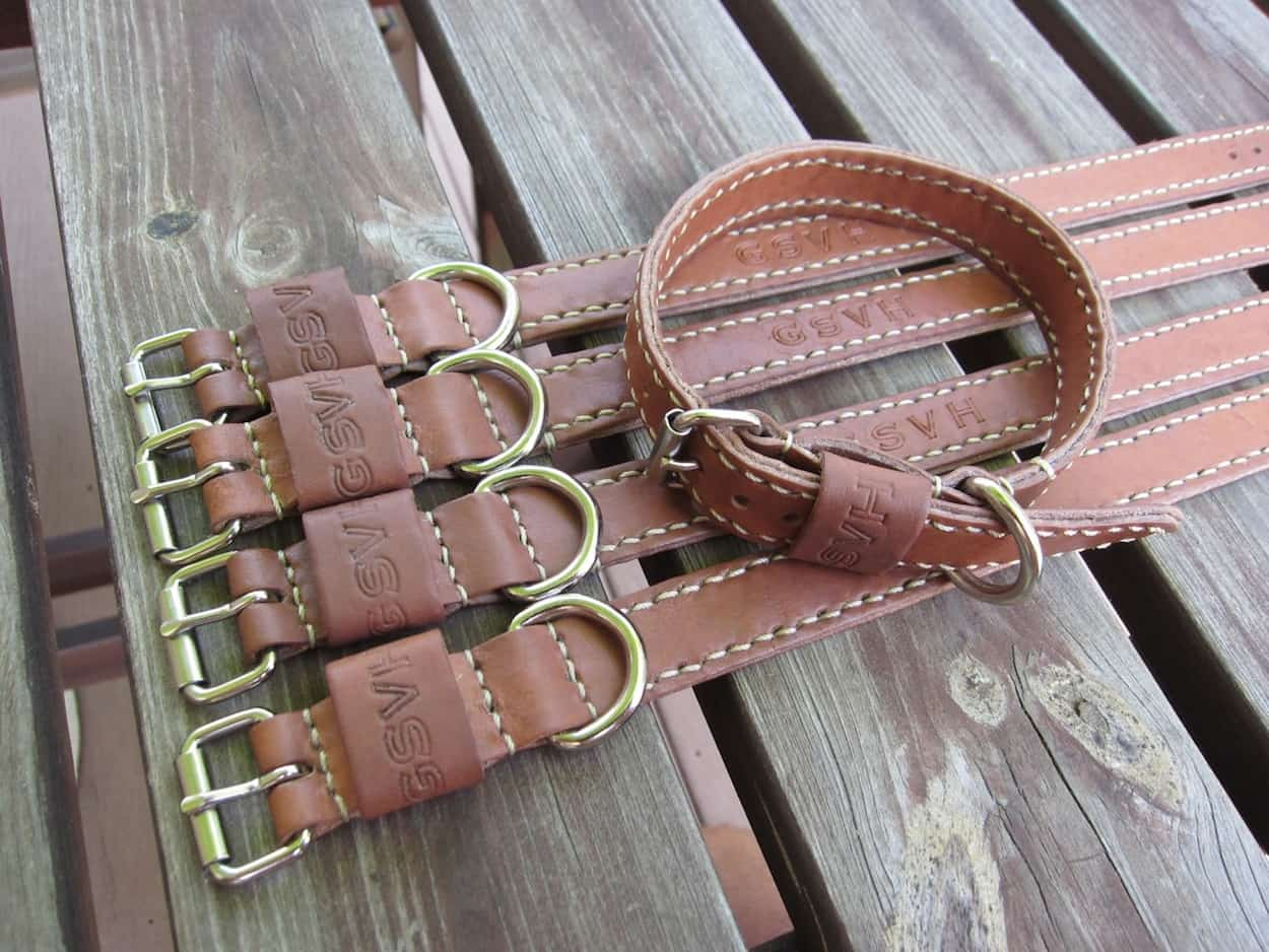 A special order of cowhide dog collars - these dogs are well taken care of!