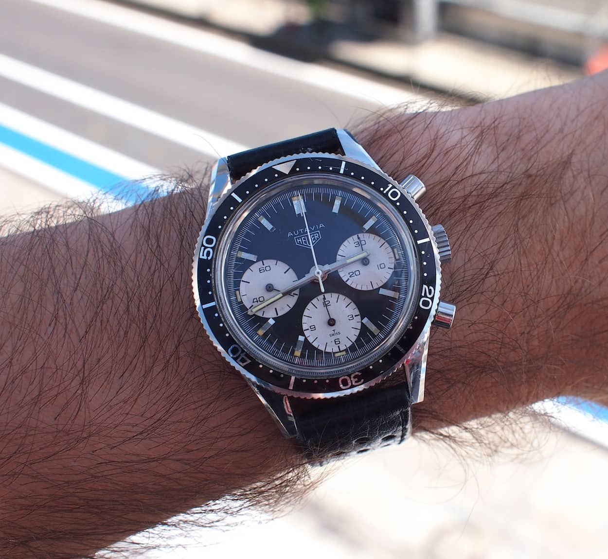Heuer Autavia 2446 on the wrist at the track